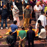 Final colourful anointing of deceased before for the short trip to the cremation platform.