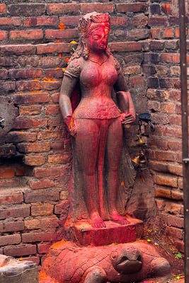 Thumbnail image ofWell anointed goddess statue atop turtle.