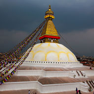 The Great Boudha Stupa under an ominous grey sky.