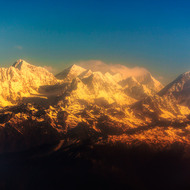 On top of the world.  Morning view of the Himalayas around Mt Everest from small aircraft.