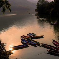 Setting sun reflected in Phewa Lake.