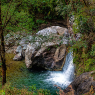 Small cascade of crystal clear mountain water on the Bhurungdi Khola.