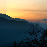 Sun coming up behind the Annapurna Range.