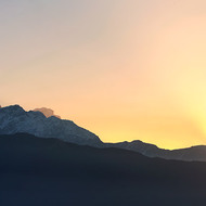 Panorama of sunrise over the Annapurna Range from Fishtail mountain, Machhapuchhre, west.