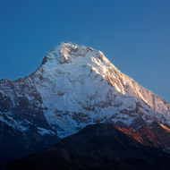 Morning sun lights up a peak in the Annapurna Range.