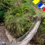 Pedestrian suspension bridge over the Kamrong Khola.