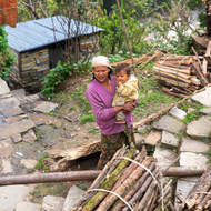 Mother and child at farmhouse beside the Modi Khola.