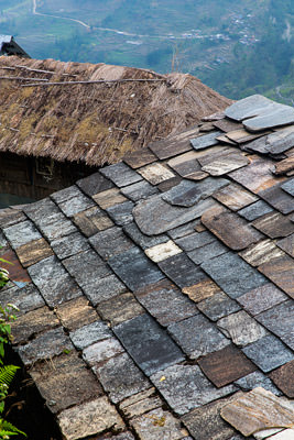 Thumbnail image ofSlate roof and thatched roof.