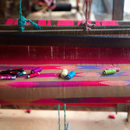 Woven scarf on weaving loom.