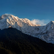 First light of the sunrise hits the peaks of the Annapurna Range.