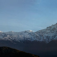 Panorama of the mountains of the Annapurna Range including Fishtail mountain, Machhapuchhre, at sunrise.