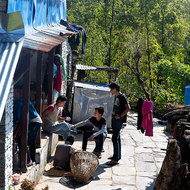 People sitting in the forecourt of a house.