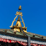 Pinnacle atop the central pagoda of Taal Barahi temple.