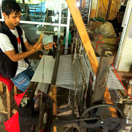 Helping Hands, visually impaired workers at weaving looms.
