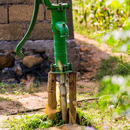 Hand pump water well.