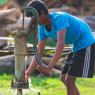 Pumping water from the well.