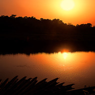 Sun getting low in the sky and reflecting in the river at Chitwan National Park.
