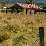 Open barn in front of the Scenic Rim escarpment.