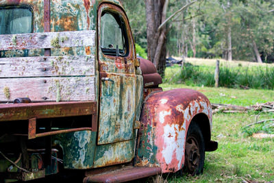 Thumbnail image of Abandoned International truck in a field by the...