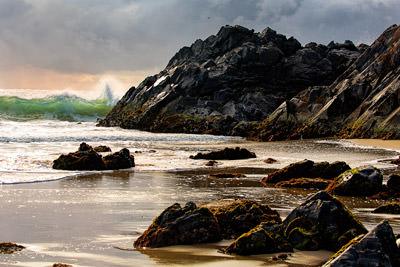 Thumbnail image ofWhoosh! Surf crashes on the rocks after sunrise.