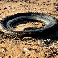 Beach debris, buried tire.