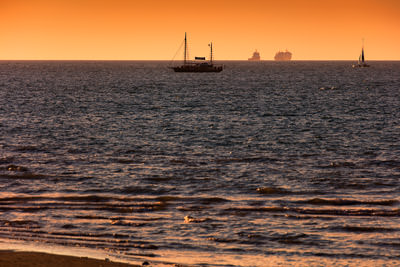Thumbnail image ofBusy time out to sea at dusk.