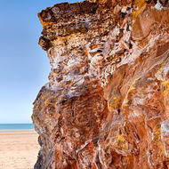 Coastal cliff of sedimentary rock.