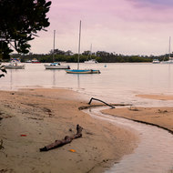 Yachts at evening rest on the run out tide, Noosa River.