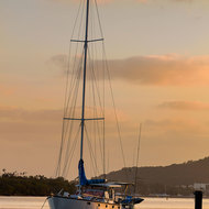 Yacht on Noosa River at dawn.