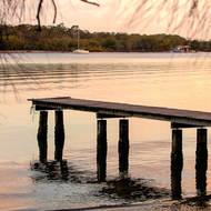 Early morning light over empty Noosa River jetty.