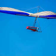 Hang glider soaring above Lennox Head.