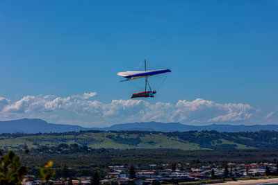 Thumbnail image ofHang glider back dropped by Lennox Head township.