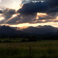 Setting sun shoots rays over Mt Barney.