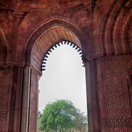 Through the arch from the Quwwat-ul-Islam mosque.