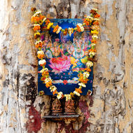 Decorated religious marker on a tree.