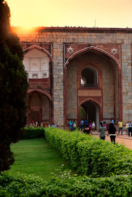 Thumbnail image of Sun setting over entrance gateway to Humayun's...