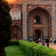 Sun setting over entrance gateway to Humayun's Tomb.