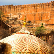 Golden dome in Amber Fort in front of Jaigarh Fort.