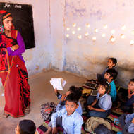 Teacher and students at a small rural school.