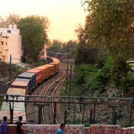 As the sun sets a freight train threads through Agra.