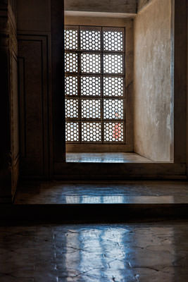 Thumbnail image of Looking out through carved marble window.