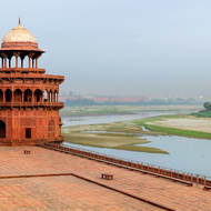 Taj Mahal river front terrace, north-west wall tower and the Red Fort up the Yamuna River.