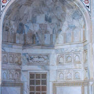 Taj Mahal side arch, carved marble window and frescoes.