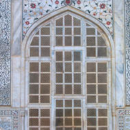 Carved marble window and frescoes.