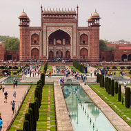 Taj Mahal Darwaza gate, Bagh tomb gardens and Hawz pool from the south side of the mausoleum.
