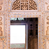 Intricate marble carving over doorway.