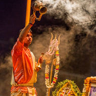 Aarti, evening prayers, with incense, bells and trident.