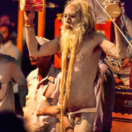 A Naga Sadhu at Aarti, evening prayers, on the bank of the River Ganges.