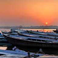 Sun rising in a hazy dawn over River Ganges.