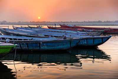 Thumbnail image ofSun rising in a hazy dawn over River Ganges.